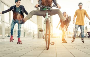 54080797 - group of active teenagers in town. four teens making recreational activity in an urban area