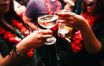 50149027 - clinking glasses with alcohol and toasting, party. congratulations to the event. cheerful party friends