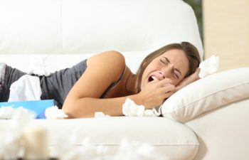 50532252 - girl crying desperately lying on a couch at home with a lot of wipes