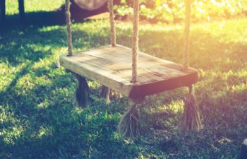 61138263 - empty wooden swing in children playground with vintage filter