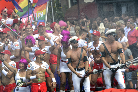 58005033 - amsterdam, netherlands - august 2, 2014: participants in the annual event for the protection of human rights and civil equality - gay pride parade on the prinsengracht, amsterdam