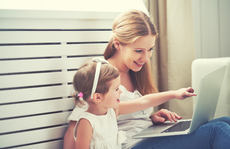 50841351 - family mother and child daughter at home with a laptop