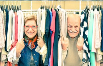 39317127 - playful senior couple at weakly flea market - concept of active elderly with mature man and woman having fun and shopping in the old town - happy retirement moments on a warm vintage nostalgic look