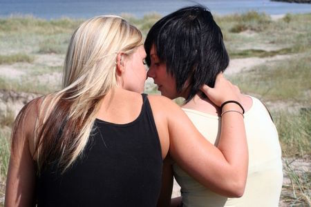 7104376 - two women kissing in the sun