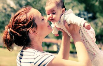 28366197 - portrait of happy loving mother and her baby outdoors