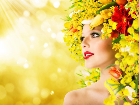 60366919 - model with hairstyle with flowers and makeup