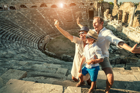 46754771 - funny family take a self photo in amphitheatre building