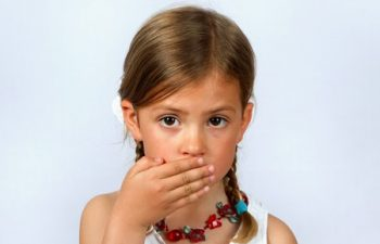 6990524 - little girl with hand over her mouth