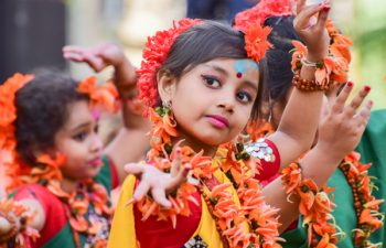 54543430 - kolkata , india - march 5, 2015 : girl child dancers performing at holi  spring festival, known as dol in bengali or holi in hindi celebrating arrival of spring in india. a very popular festival amongst bengalis.