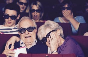 18710502 - senior couple watching 3d film in cinema