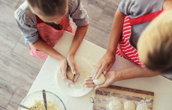 44715952 - mom with her 9 years old daughter are cooking in the kitchen to mothers day, lifestyle photo series in bright home interior, top view point