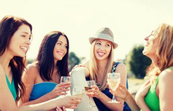 28635456 - summer holidays and vacation - girls with champagne glasses on boat or yacht