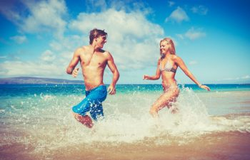 52155761 - happy attractive young couple on tropical beach